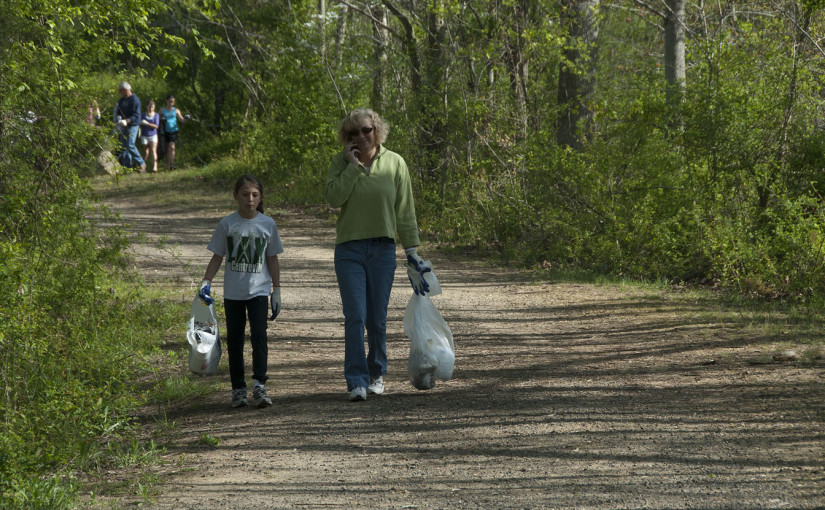 Mom and daughter picking up trash around the Corsica River watershed areas